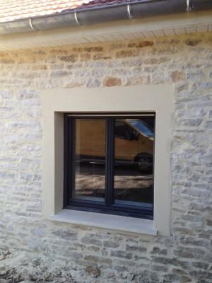 Entourage de fenêtre en enduit de façade